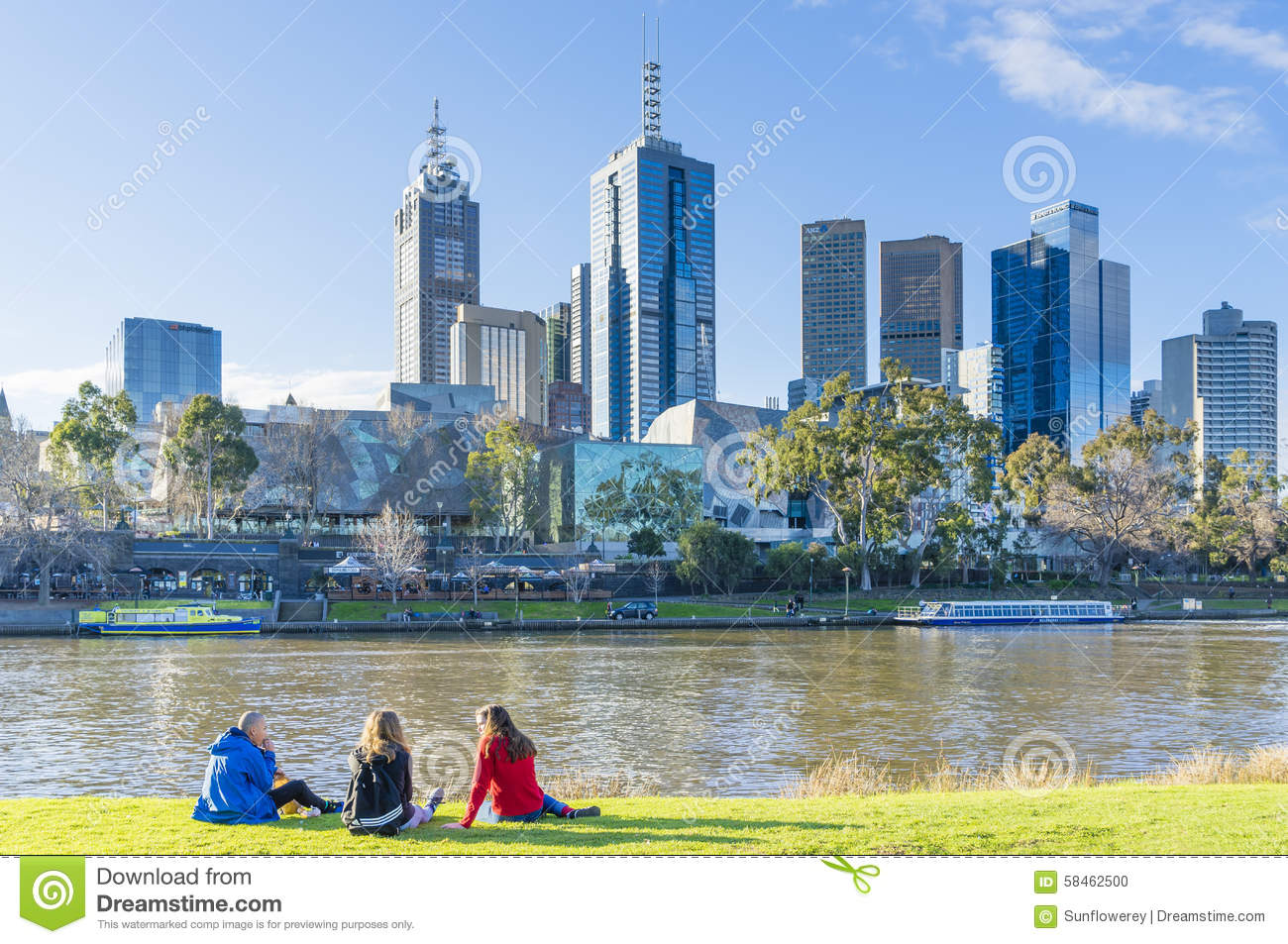 People Sitting On Banks Of Yarra River In Melbourne Editorial.