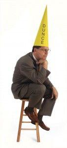 Man wearing a dunce cap.