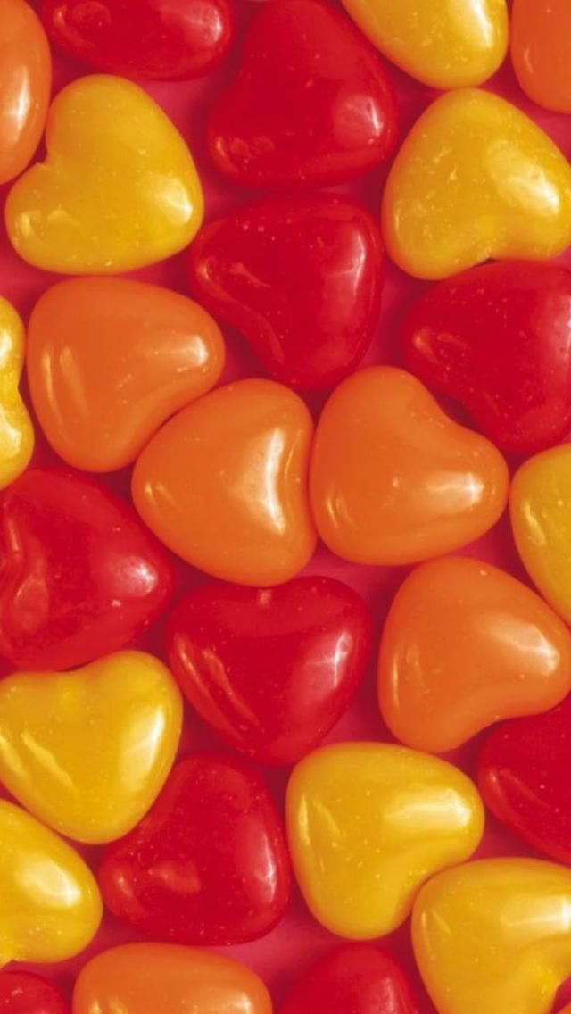 orange and yellow heart shape candy.
