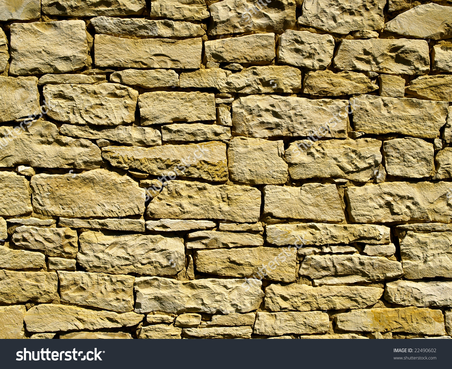 Yellow Ochre Stone Wall Made Of Marlite (Kind Of Rock) Stock Photo.