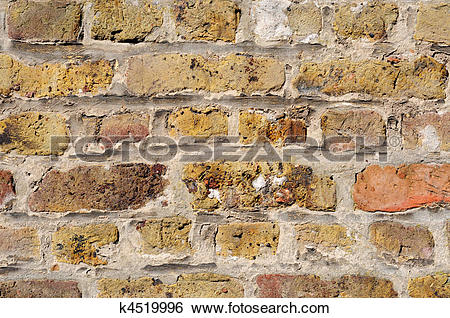 Stock Images of Old brick wall in shades of yellow, ochre, and.