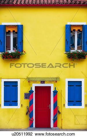 Stock Photo of Burano: house facade with brightly painted yellow.