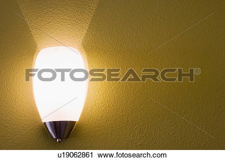 Stock Photography of Wall sconce on yellow wall u19062861.
