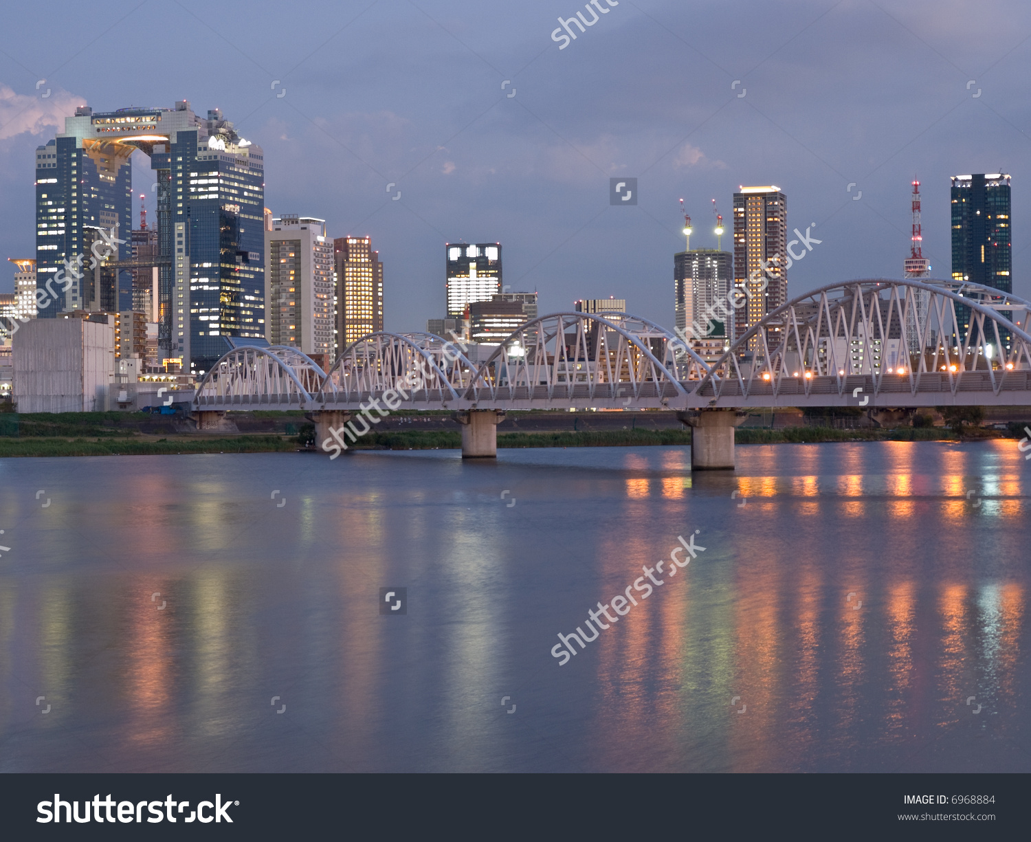 Night Scene Of Bridge Crossing Yodo River With Reflections In The.