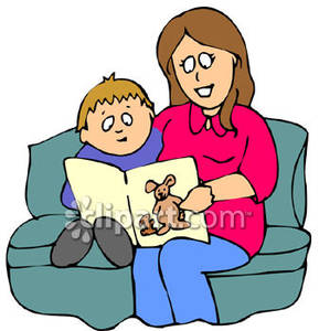 A Mother and Son Read a Book, Sitting on Couch Royalty Free.