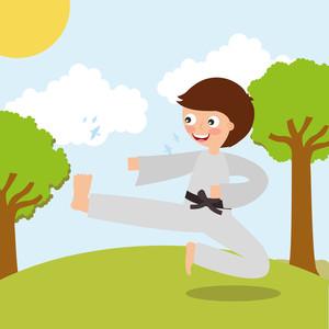 little boy training karate martial art sport in landscape.