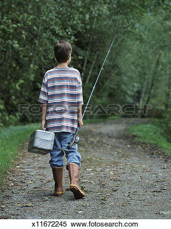 Stock Image of Rear View of a Young Boy Walking Down a Forest Path.