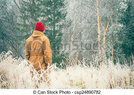 Pictures of Young Man walking alone outdoor with foggy.
