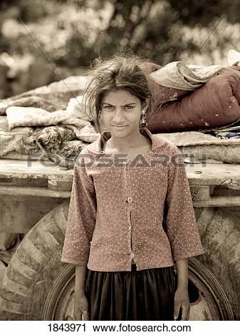 Stock Photography of Portrait Of Young Indian Gypsy Girl,Sitting.