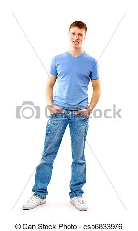 Stock Image of Young man standing with hands in pockets.