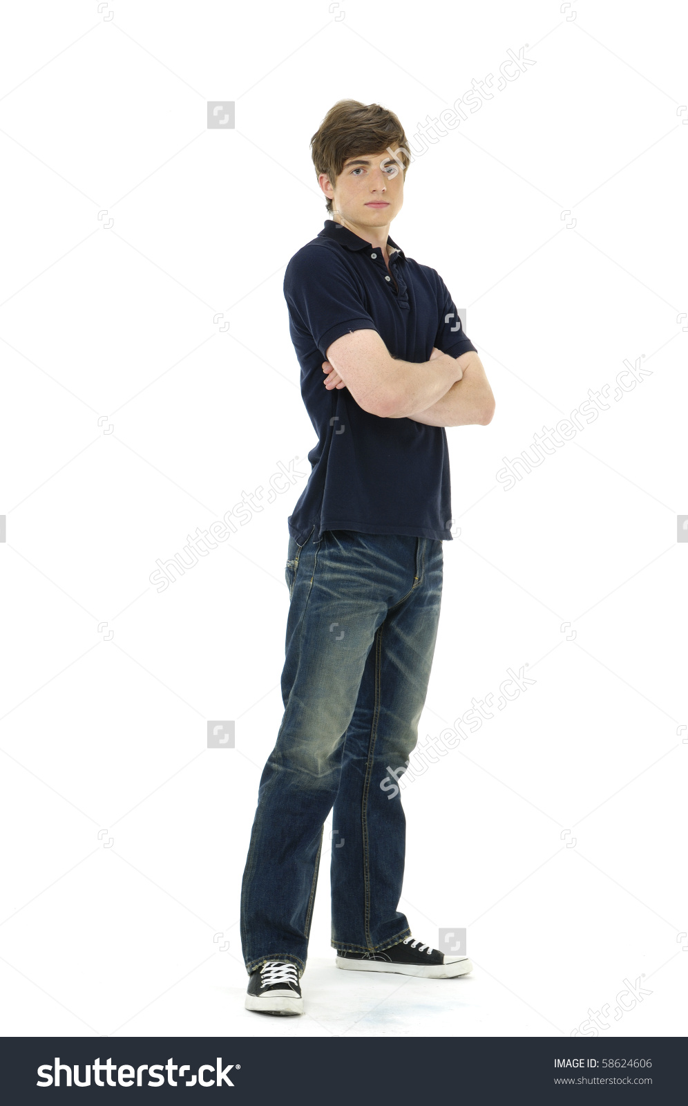Young Man Standing His Arms Folded Stock Photo 58624606.