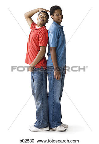 Stock Photography of Profile of a teenage boy and a young man.