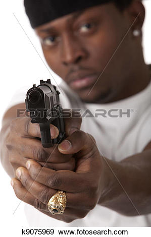 Stock Photograph of Young thug with a gun k9075969.