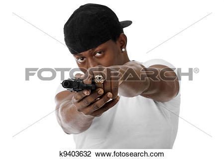 Stock Photo of Young thug with a gun k9403632.