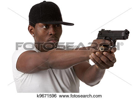 Stock Images of Young thug with a gun k9671596.
