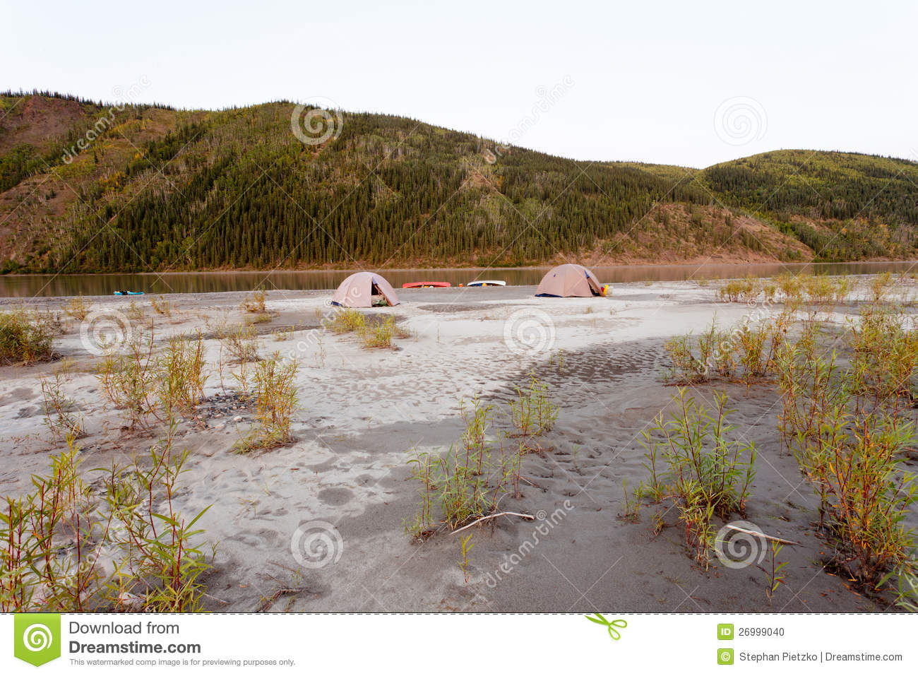 Wilderness Camping On Shore Of Yukon River, Canada Stock Photo.