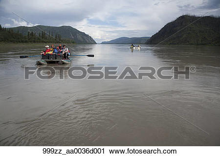 Stock Photography of Two rafts of families float down the Yukon.