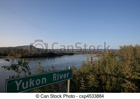 Stock Photo of Yukon River sign post in front of streaming Yukon.