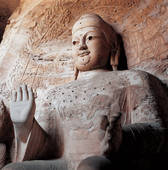 Stock Photo of Close up of stone Buddha of Yungang Grotto in.