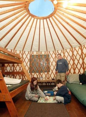 Think outside the tent: yurts, cabins in parks.