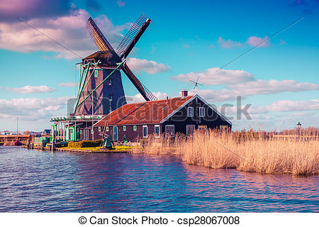 Stock Photography of Authentic Zaandam mills on the water channel.