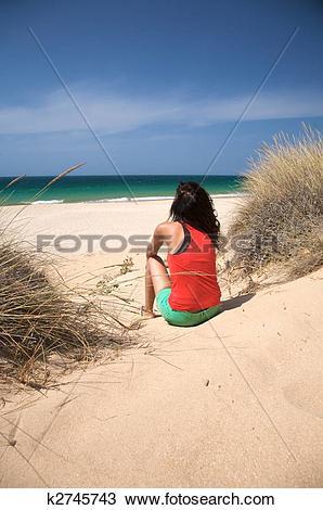 Stock Photo of sitting back woman beach k2745743.