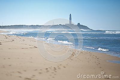 Trafalgar Beach With Lighthouse Stock Photo.