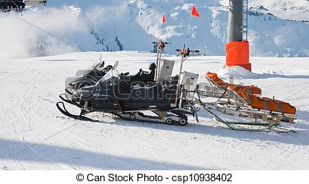 Stock Photography of Snowmobile and trailer. Ski resort Zell am.
