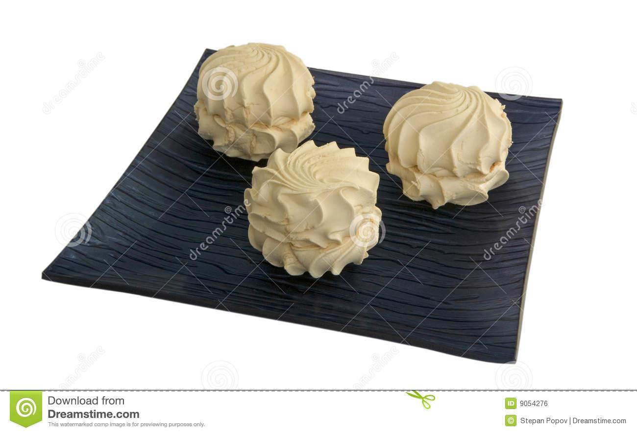Cream Zephyr On A Black Dish Royalty Free Stock Image.