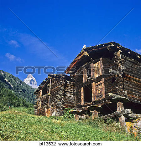 Stock Photo of Mazot, traditional wooden raccards and top of the.