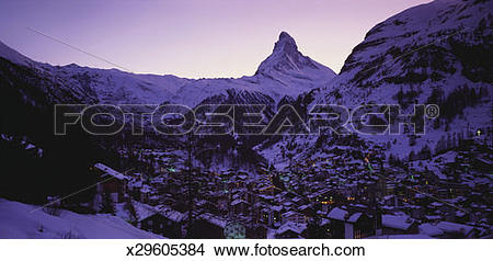 Stock Photo of Matterhorn Mountain and Town at Twilight, Zermatt.