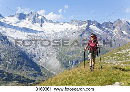 Stock Photography of Woman hiking in the Zillertal Alps, Tyrol.