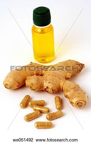Stock Photo of Ginger oil and pills (Zingiber oficinale) we051492.