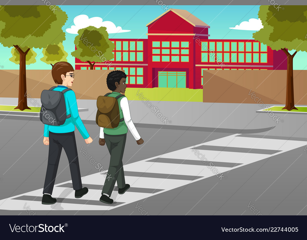 Students crossing the street to schooll.