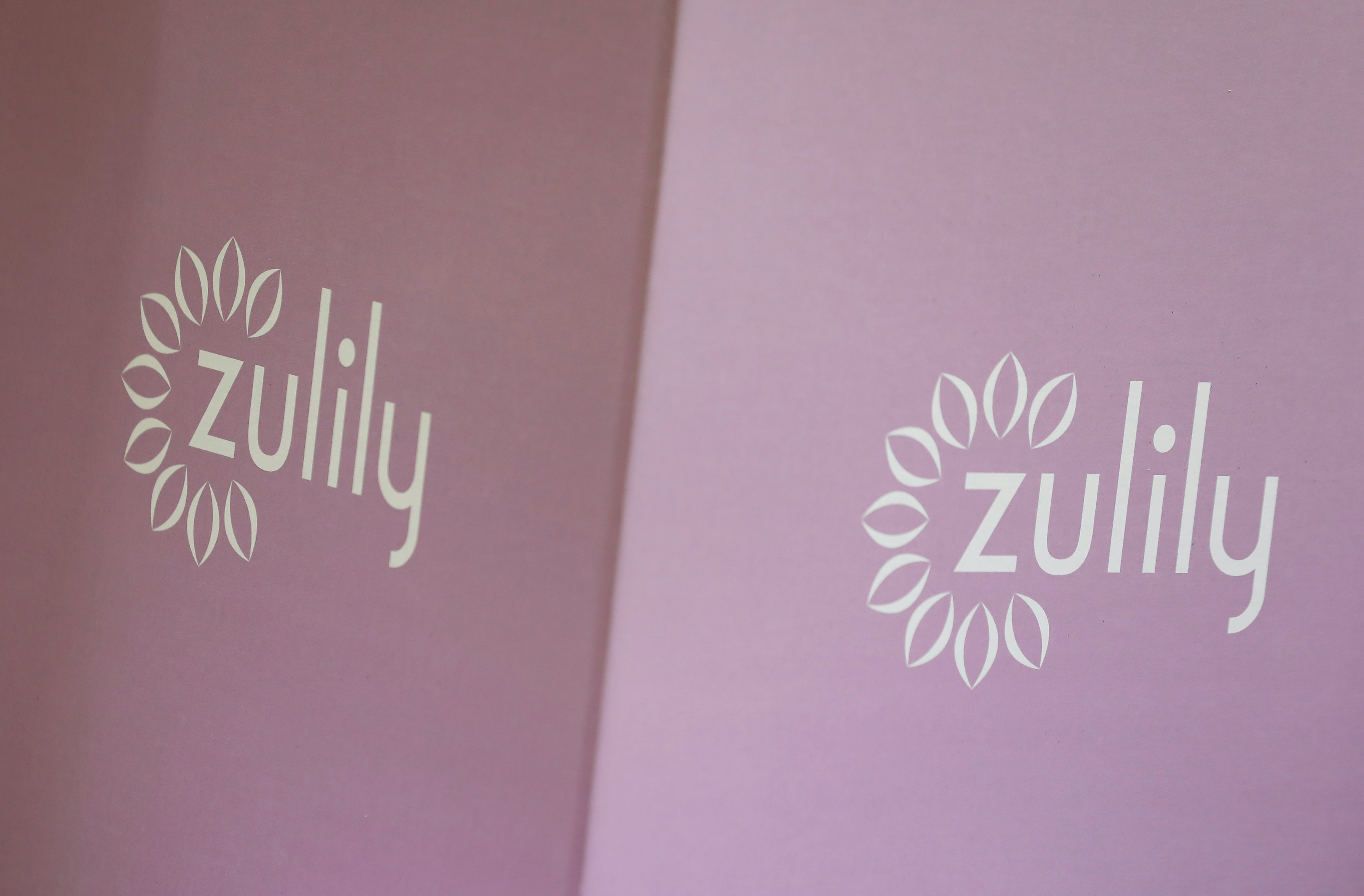 A Zulily logo, which is a subsidiary of QVC parent.